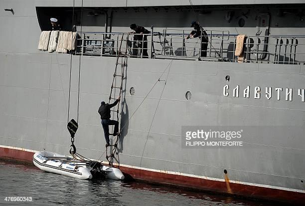 Ukrainian navy sailor boards the Ukrainian navy ship Slavutych in the port of Sevastopol, where a Ukrainian navy base is located, on March 6, 2014....