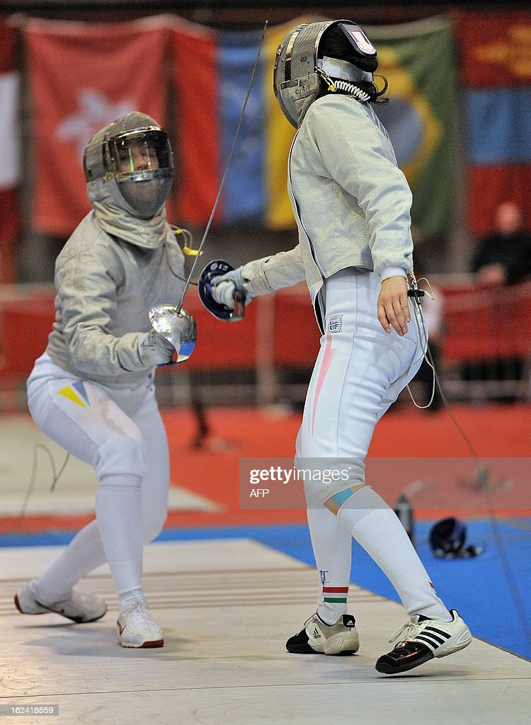 Ukrainian Olga Kharlan and Hungarian Julia Mikulik compete during the 'Challenge Yves Brasseur' women's fencing World Cup tournament, on February 23, 2013, in Drongen., Belgium.