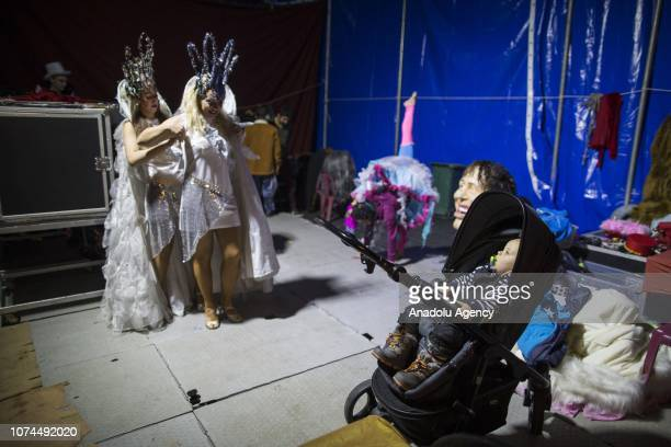 Ukrainian performer Anna prepares for a performance beside her son Milan at an animalfree circus in Ankara Turkey on December 15 2018 Anna and Igor...