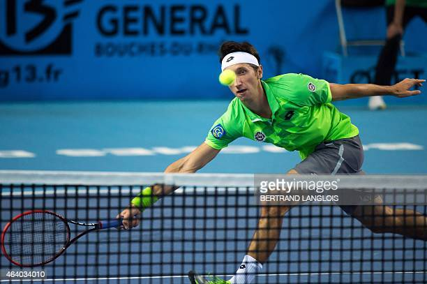 Ukrainian player Sergiy Stakhovsky returns a ball to French player Gilles Simon during the Open 13 semi-final tennis match in Marseille, southern...