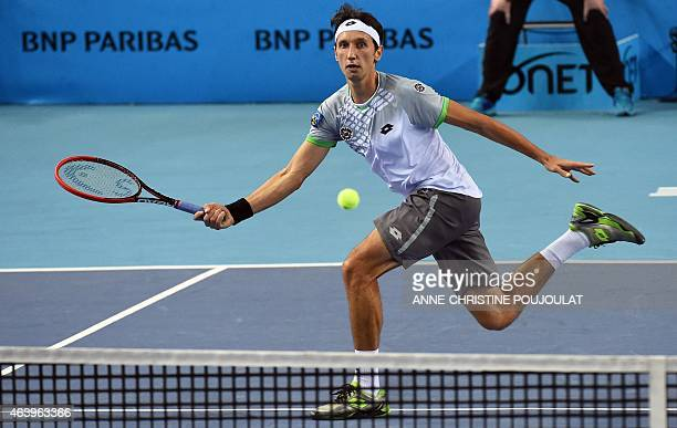 Ukrainian player Sergiy Stakhovsky returns the ball to Swiss player Stan Wawrinka during their Open 13 final-quarter tennis match on February 20,...