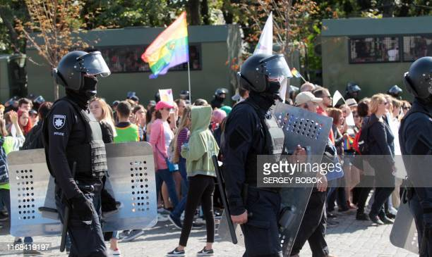 Ukrainian police escort activists from the LGBT community during the Kharkiv Pride march in Kharkiv on September 15 2019