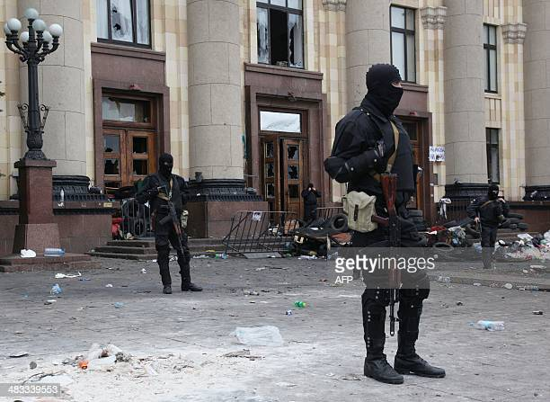 Ukrainian policemen stand guard in font of the Kharkiv regional state administration building on April 8 2014 Ukrainian policemen were injured as a...