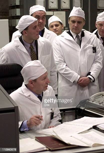 Ukrainian President Leonid Kuchma signs the engineering events log book during a visit to Chernobyl nuclear power plant's third reactor's control...