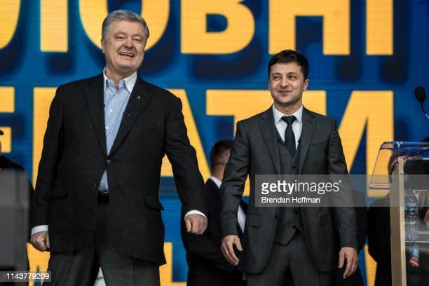 Ukrainian President Petro O Poroshenko and his electoral opponent Volodymyr Zelenskiy before a debate at Olympiskiy Stadium on April 19 2019 in Kiev...