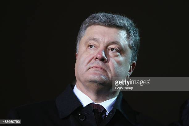 Ukrainian President Petro Porosehnko attends an evening ceremony to commemorate victims of the Maidan uprising one year ago at Maidan square on...