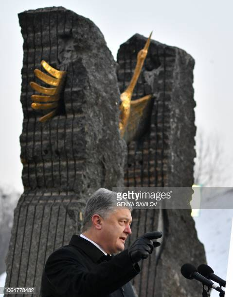 Ukrainian President Petro Poroshenko addresses to audience during a commemoration ceremony at a monument to victims of the Holodomor famine of 193233...
