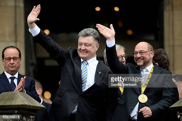 Ukrainian President Petro Poroshenko and European Parliament President Martin Schulz gesture during the International Charlemange Prize Of Aachen...