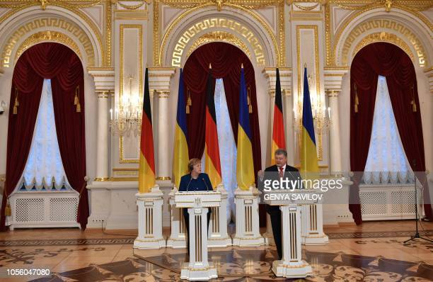 Ukrainian President Petro Poroshenko and German Chancellor Angela Merkel hold a joint press conference following their talks in Kiev on November 1...