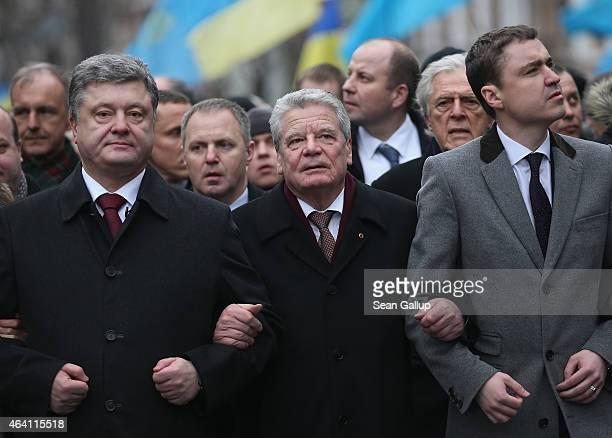 Ukrainian President Petro Poroshenko and German President Joachim Gauck walk arm in arm in the March of Diginity prior to ceremonies marking the...