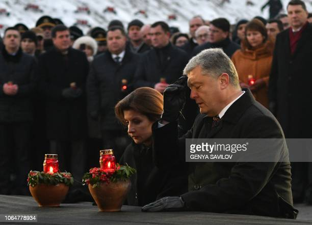 Ukrainian President Petro Poroshenko and his wife Maryna Poroshenko pay their respects as theytake part in a commemoration ceremony at a monument to...