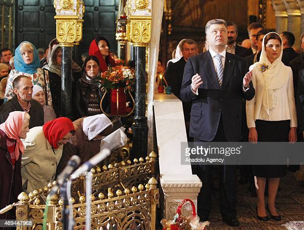 Ukrainian President Petro Poroshenko and his wife Maryna Poroshenko attend the Easter Mass led by Patriarch Filaret head of the Ukrainian Orthodox...