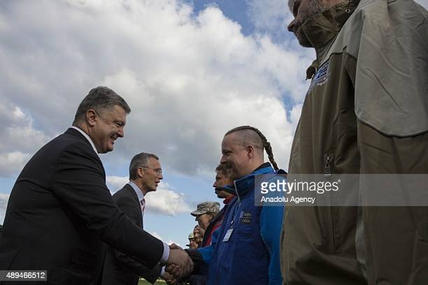 Ukrainian President Petro Poroshenko and NATO Secretary General Jens Stoltenberg talk with soldiers in Lviv western Ukraine on September 21 2015...