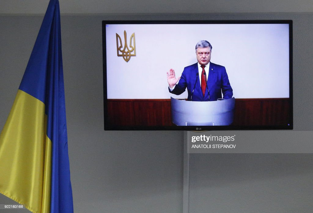 Ukrainian President Petro Poroshenko appears on a screen as he is questioned during a court hearing in Kiev on February 21, 2018, in the case of Ukraine's ex-president. A Kiev district court questioned Poroshenko through video communication as a witness in the state treason case of ex-president Viktor Yanukovych, who fled to Russia. /