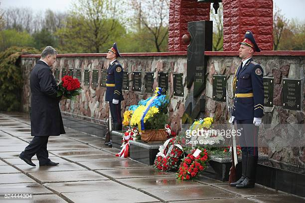 Ukrainian President Petro Poroshenko arrives to place flowers at a memorial to plant workers who died as a result of the Chernobyl nuclear accident...