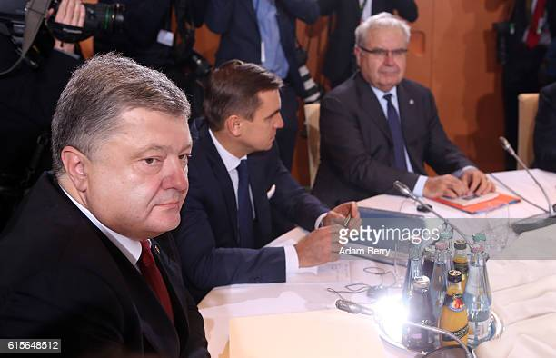 Ukrainian President Petro Poroshenko attends a meeting to discuss the Ukrainian peace process at the German federal Chancellery on October 19 2016 in...