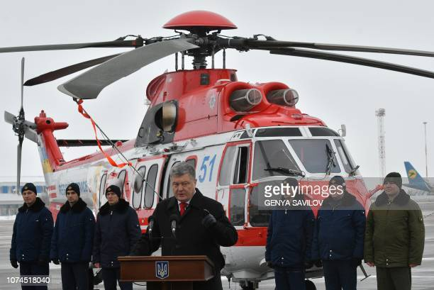 Ukrainian President Petro Poroshenko delivers a speech during the two Airbus H225 Super Puma helicopters handover ceremony for Ukrainian national...