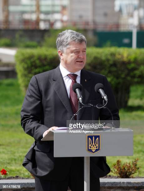 Ukrainian President Petro Poroshenko delivers a speech in front of the new protective shelter over the nuclear reactor Unit 4 at Chernobyl nuclear...