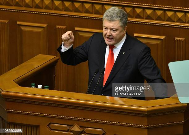 Ukrainian President Petro Poroshenko delivers his speech from Parliament tribune during an emergency session in Kiev on November 26 ahead of a...