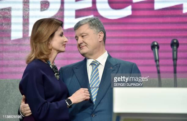 Ukrainian President Petro Poroshenko embraces his wife Maryna to thanks her for her support in the Poroshenko's party headquarters in Kiev on April...