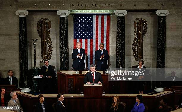 Ukrainian President Petro Poroshenko flanked by US Vice President Joe Biden and Speaker of the House John Boehner addresses a joint meeting of the US...