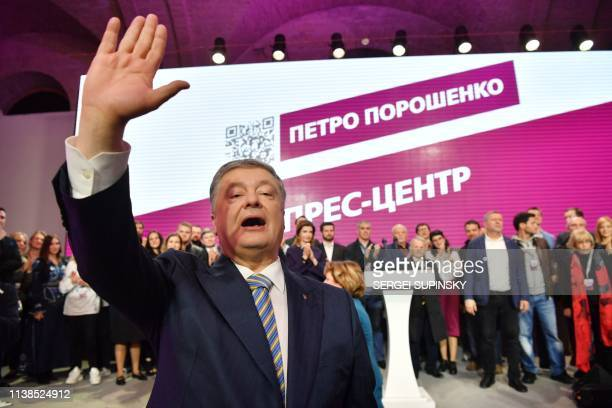 Ukrainian President Petro Poroshenko gestures as he and his team thank his supporters at the party headquarters in Kiev on April 21 at the end of a...