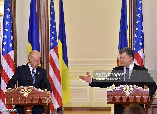 Ukrainian President Petro Poroshenko gestures as he speaks flanked by US Vice President Joe Biden as they deliver a statement on the results of talks...