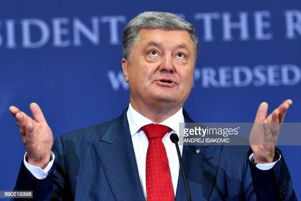 Ukrainian President Petro Poroshenko gestures during a joint press conference with Serbian President after their meeting in Belgrade on July 3 2018