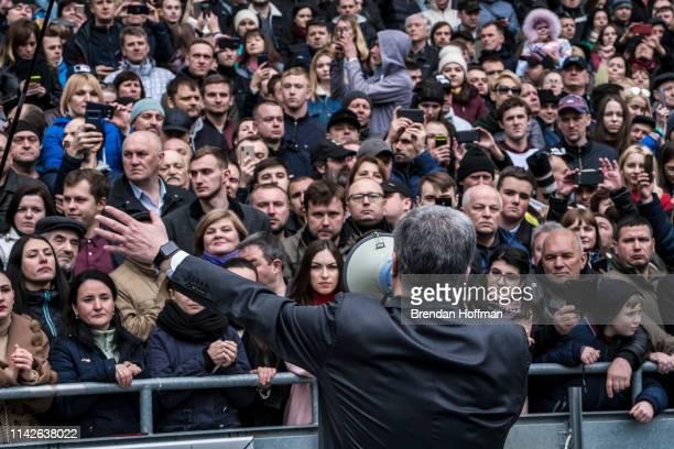 Ukrainian President Petro Poroshenko holds a campaign rally inside Olympiskiy Stadium on April 14 2019 in Kiev Ukraine Zelenskiy a television...