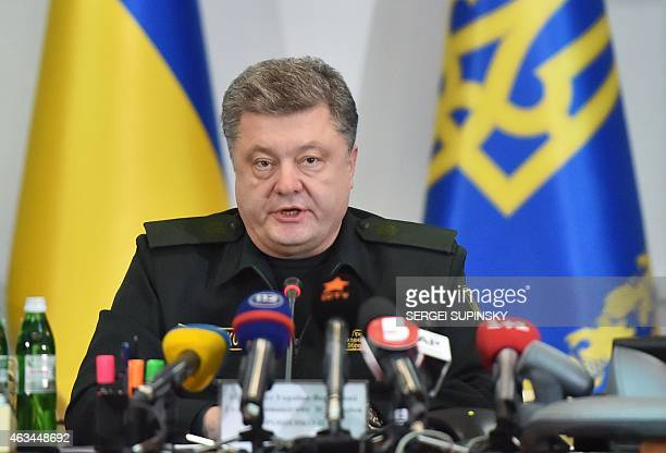 Ukrainian President Petro Poroshenko orders the military to implement a ceasefire during a live broadcast in Kiev early on February 15 2015 The peace...