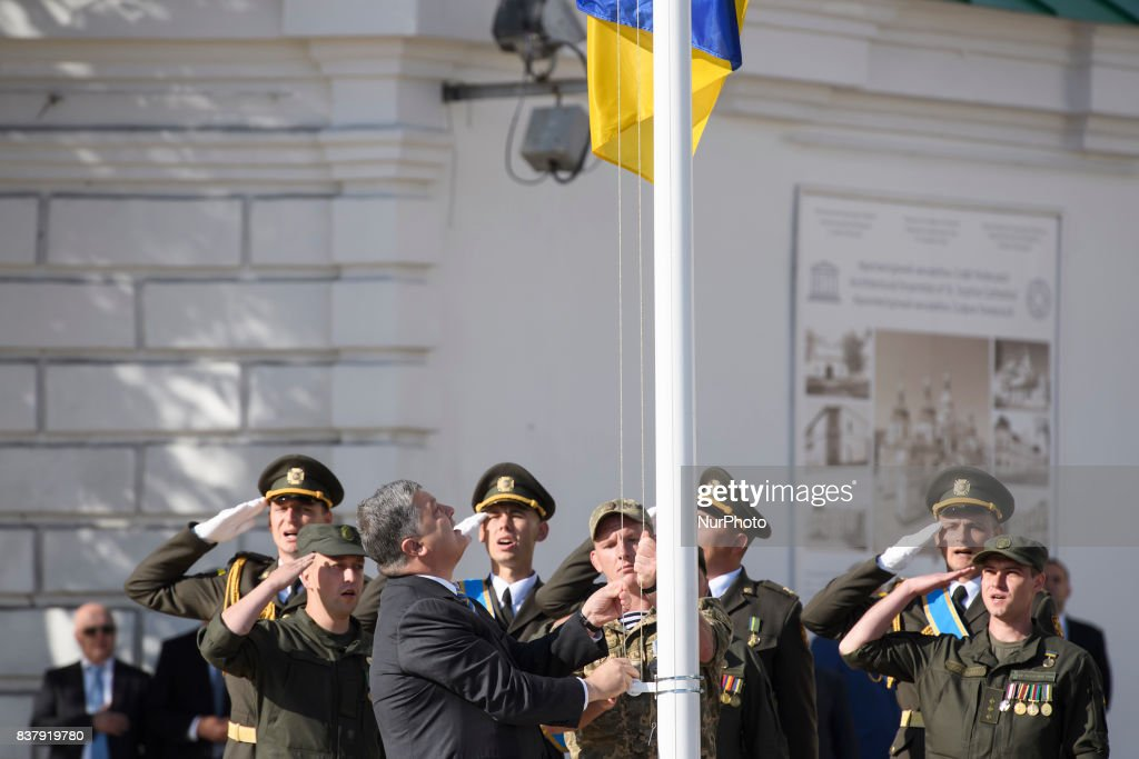 Ukrainian President Petro Poroshenko (L) raises the National Flag at the St. Sophia square in downtown Kyiv, Ukraine, 23 August 2017. Ukrainians mark the National Flag Day, one day prior to Independence Day, which is celebrated on 24 August.