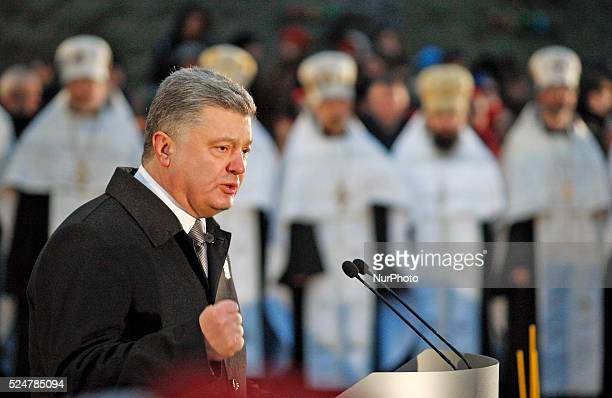 Ukrainian President Petro Poroshenko speaks during a memorial ceremony near a monument to the victims of the Great Famine in Kiev, Ukraine,28...