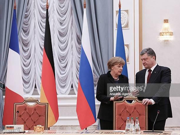 Ukrainian President Petro Poroshenko speaks with German Chancellor Angela Merkel during the peace talks over the situation in Eastern Ukraine with...
