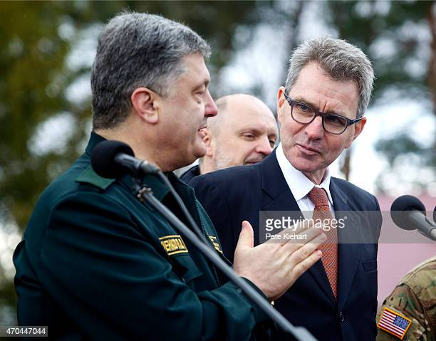 Ukrainian President Petro Poroshenko takes questions from the media as US Ambassador to Ukraine Geoffrey Pyatt looks on during the opening ceremony...