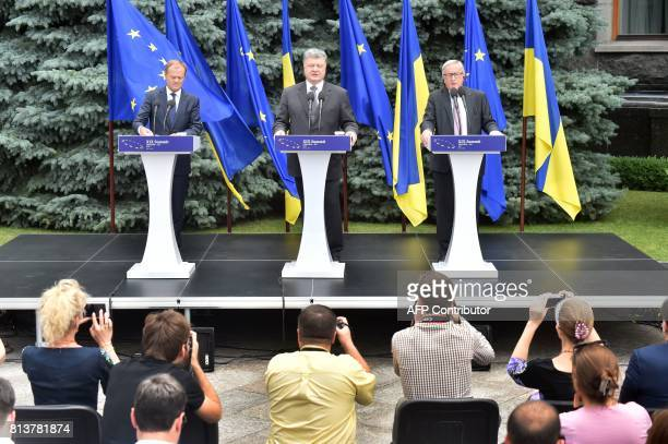 Ukrainian President Petro Poroshenko the President of the European Council Donald Tusk and the President of the European Commission JeanClaude...