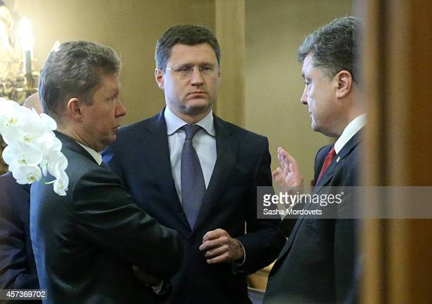 Ukrainian President Pyotr Poroshenko talks to Gazprom's CEO Alexei Miller and Russian Minister of Energy Alexander Novak during the ASEM Summit on...