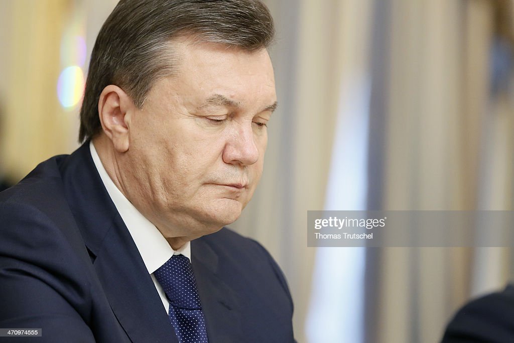 Ukrainian President Viktor Yanukovych arrives before the signing of the Agreement in the Presidential Palace on February 21, 2014 in Kiev, Ukraine. Yesterday Steinmeier and his counterparts from France and Poland meet with President Yanukovych and other government officials and hold separate talks with the opposition.