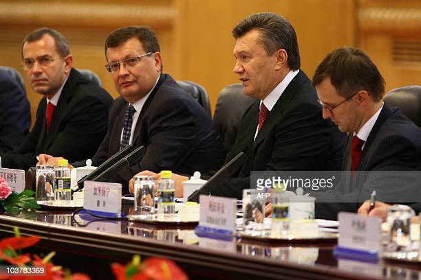 Ukrainian President Viktor Yanukovych talks with Chinese President Hu Jintao during a meeting at the Great Hall of the People in Beijing on September...