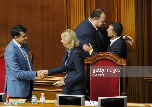 Ukrainian President Volodymyr Zelensky and Deputy Speaker Ruslan Stefanchuk hug after the lawmakers voted for cancels parliamentary immunity during a...