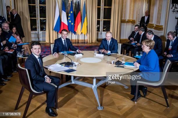 Ukrainian President Volodymyr Zelensky, French President Emmanuel Macron, Russian President Vladimir Putin and German Chancellor Angela Merkel attend...