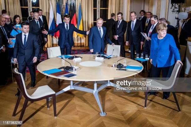Ukrainian President Volodymyr Zelensky French President Emmanuel Macron Russian President Vladimir Putin and German Chancellor Angela Merkel attend a...