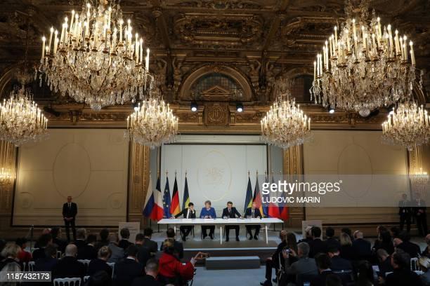 Ukrainian President Volodymyr Zelensky German Chancellor Angela Merkel French President Emmanuel Macron and Russian President Vladimir Putin give a...