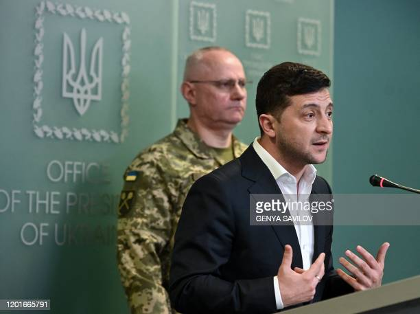 Ukrainian President Volodymyr Zelensky speaks flanked by Ruslan Khomchak military commander of the Armed Forces of Ukraine at a briefing following an...