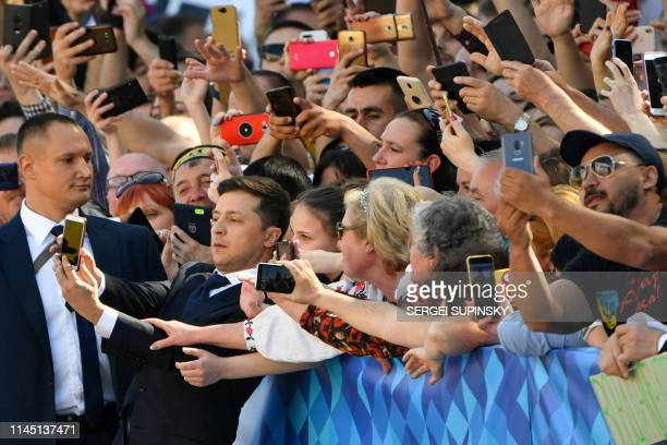 Ukrainian presidentelect Volodymyr Zelensky takes selfie pictures with supporters prior to his inauguration ceremony at the parliament in Kiev on May...