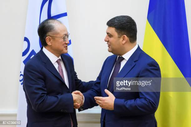 Ukrainian Prime Minister Volodymyr Groysman greets World Bank President Jim Yong Kim in Kyiv Ukraine November 14 2017