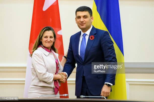 Ukrainian Prime Minister Volodymyr Groysman shakes hands with Canada's Minister of Foreign Affairs Chrystia Freeland during their meeting in Kyiv...