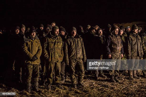 Ukrainian prisoners of war are held by proRussian rebels before a prisoner exchange on February 21 2015 near Zholobok Ukraine Ukrainian forces...