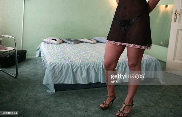 A Ukrainian prostitute stands in front of a bed in a brothel in an appartment in Berlin 12 September 2007 AFP PHOTO DDP/AXEL SCHMIDT GERMANY OUT