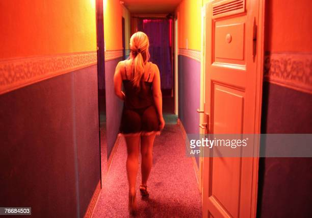 A Ukrainian prostitute walks towards a room in a brothel in an appartment in Berlin 12 September 2007 AFP PHOTO DDP/AXEL SCHMIDT GERMANY OUT