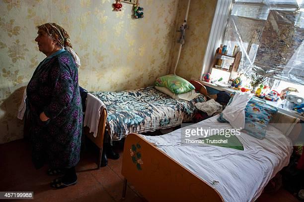 Ukrainian refugee stands in refugee accommodations in on October 14 2014 in Kharkiv Ukraine German Development Minister Gerd Mueller is on a twoday...